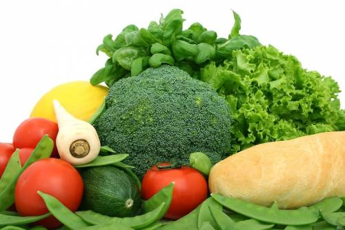 Fresh vegetables, spinach and bread
