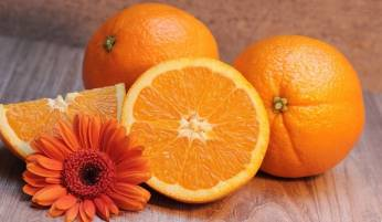 Three oranges and a flower