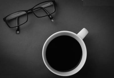 Cup of coffee and glasses