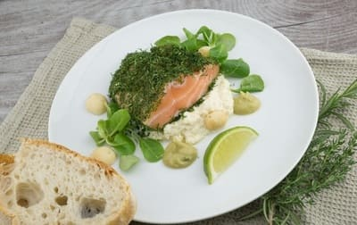 Fried salmon with herbs on a plate